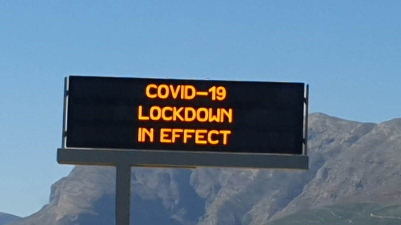 COVID-19 sign on the N1 highway in the Western Cape, South Africa, taken April 2020.